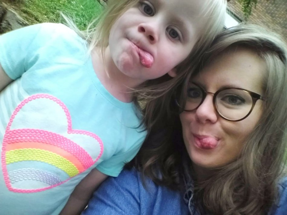Young girl and her mom stick out their tongues while posing for a selfie - You Will BEE Fine blog
