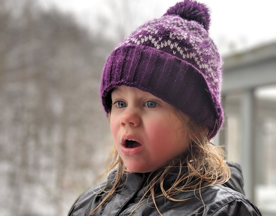 Young girl with a frustrated expression outside in a snowy scene - You Will BEE Fine blog